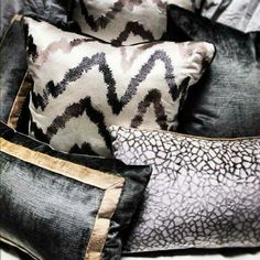 Black, beige and gold fabrics. Mixture of patterns and textures.
