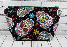 Dia de los Muertos make up bag. Day of the Dead cosmetic bag This listing is for a 100% cotton make up bag, featuring a Day of the Dead print, with a black lining. It is finished with a green zip. Thi