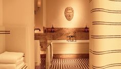 B&W Mosaic Tiled Floor, Brown Marble Counter and Sink, and Undulating Deco Style Wall. The Hotel de Russe, Rome. So Handsome. Bathroom Wall, Bathroom Interior, Modern Bathroom, Bathroom Tiling, Bathroom Black, Classic Bathroom, Bad Inspiration, Bathroom Inspiration, Haus Am Hang