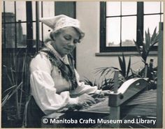 """Mrs. Inga Roos at a loom. On back of photograph: """"Mrs. Inga Roos - a teacher of Swedish weaving for the Manitoba Branch of the Canadian Handicrafts Guild. 1930's 206 Paris Building"""""""