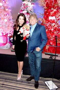 """""""Real Housewives of Beverly Hills"""" stars Lisa Vanderpump and husband Ken Todd posed with their tiny pup Giggy while getting into some holiday festivities on Dec. 5, 2014 at the Palm Springs Festival of Lights parade."""