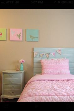 My DIY girls room. Headboard artwork nightstand and banner.
