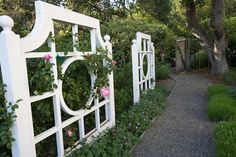 Simple, classic rose trellises lining the pathway to the garden. Discovered on porch.com