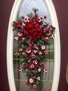 Christmas Wreath Winter Wreath Vertical Teardrop Door Swag Decor..Peppermint Candy. $89.00, via Etsy.