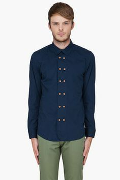 Diesel Navy Sirmargl RS Shirt on shopstyle.com | Long sleeve double breasted buttondown shirt in navy. Spread collar. Tan buttons. Three button cuffs. Shirttail hem. Tonal stitching. 97% cotton, 3% elastane. Machine wash cold. Imported.
