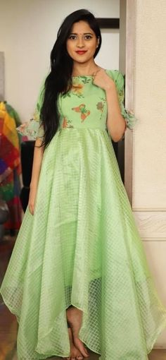 Beautiful pista green color asymetric high low dress with butterfly design print on yoke. To order whatsapp 7013728388 . Indian Gowns Dresses, Indian Fashion Dresses, Dress Indian Style, Long Gown Dress, Frock Dress, Long Gown Design, Frock Models, Floral Skirt Outfits, Girls Frock Design