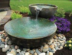 A small fountain enhances backyard relaxation - 6 Top Picks for a Relaxing… Backyard landscaping water features