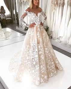 Item Description : A Glamorous Tulle Ball Gowns Dress Featuring A Illusion Neckline With Lace Embroidery and long sleeves,,Open Back Design,Perfect for your church wedding,indoor wedding,color available in white,ivory,champagne or customized Size Chart: Dresses Process Time: 14 to 20 days Customized :Yes Shipment Metho