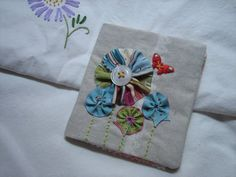 a stitched needlebook