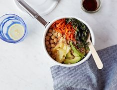 Full of protein from the quinoa, healthy fats from the sunflower seeds and avocado, and iron from the kale, this vegan grain bowl is easy to make, good for you, and seriously delicious.