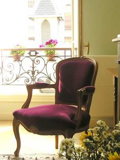 Purple-magenta velvet chair
