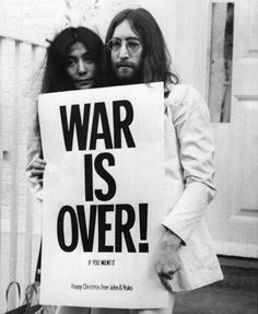 Yoko Ono and John Lennon with peace campaign poster against the Vietnam War, 1969. Photograph by Frank Barratt/Getty Images.
