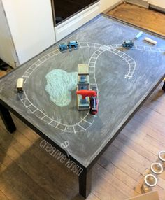 coffee table painted with chalkboard paint to be a train table (ledges added)