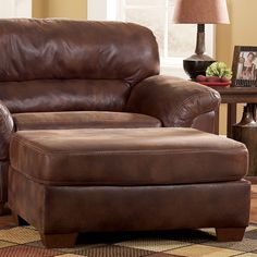 """The """"Frontier-Canyon"""" upholstery collection features rich upholstery fabric surrounding a stylish contemporary frame to create the ultimate collection to enhance the beauty and comfort of any living area. With the soft feel of the faux leather upholstery fabric covering the plush pillow top arms and stylishly stitched bustle back design, this furniture provides the comfort you deserve. The warm fabric tones and rich finished tapered block feet help create an inviting contemporary design…"""