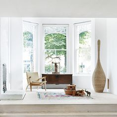 The bright living space is uncluttered and bathed in natural light, its white palette creating a fresh, modern feel. Located in east London, this four-stor