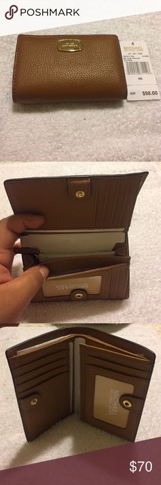 Michael Kors Wallet Brand new with tags Michael Kors bifold wallet.  In the color Acorn. 6 card slots, coin and bill compartment. Michael Kors Bags Wallets