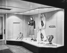 """Russell's Department Store, 64-66 East Broadway. Women's dresses in window display. Sign on window reads: """"Eugene's Own Store/Russell's"""". 6 August 1945 - Catalog Number: GN389"""
