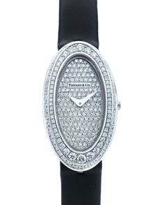 Tiffany & Co. Montre Cocktail http://www.vogue.fr/joaillerie/shopping/diaporama/montres-ultra-fines-cartier-chanel-bulgari-chaumet-tiffany/10963/image/652458#tiffany-amp-co-montre-cocktail