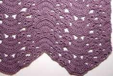 The Fans and Pansies Ripple Blanket is a gorgeous variation of the standard ripple crochet. The pattern looks wonderful in one color, but multiple colors can create an eye-catching effect.
