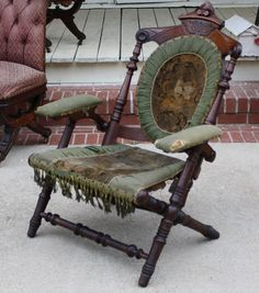 looks kind of gothic revival.  Antique Victorian Hunzinger SIGNED Chair circa 1866