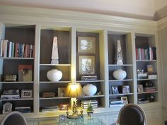 Beautiful bookshelves.  The color on the back is BM Falcon Brown 1238.  The walls and trim is BM Greenbrier Beige HC 79.