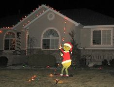 Grinch who stole Christmas lights lawn decoration.