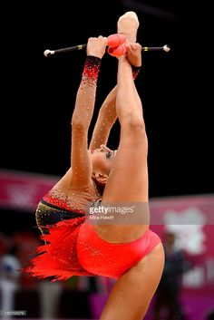 Evgeniya Kanaeva of Russia competes with the clubs during the Individual All-Around Rhythmic Gymnastics final on Day 15 of the London 2012 Olympics Games at Wembley Arena on August 11, 2012 in London, England.