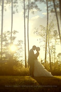 Dreamy wedding photo as sun goes down.  The Keeler Property Wedding in Jacksonville, Florida. They have a big red barn for receptions and a nice covered bridge for ceremonies. Christy Whitehead photography. Jacksonville, Florida based wedding, engagement and family photographer. Destination weddings.