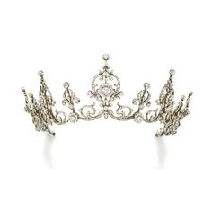 DIAMOND TIARA/NECKLACE, CIRCA 1900 Designed as a graduated series of scroll and foliate motifs connected by knife-edge linking, set with circular-cut and rose diamonds, length approximately 420mm, accompanied by two tiara frames of different heights, two small diamonds deficient, fitted case stamped Goldsmiths and Silversmiths Company.
