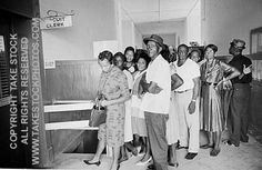 2291218. Matt Herron. Take Stock. Black citizens waiting in line at the Holmes County Circuit Clerk's office in Lexington, Mississippi to attempt to register to vote. Long waits and routine denial of applications were typical of this process.