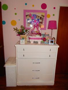 The other wall next to the closet.  the dresser was moved from my bedroom to make room for the bassinet that I will put next to my bed for all those late night feedings. The hamper is from the 1960's and in mint condition.