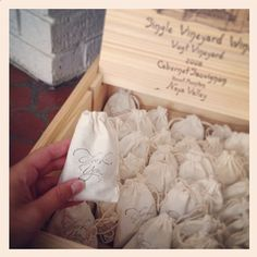 """Each cotton bag has been hand-stamped with a lovely script """"thank you"""" message, making them a perfect container for your wedding favors or wedding toss."""