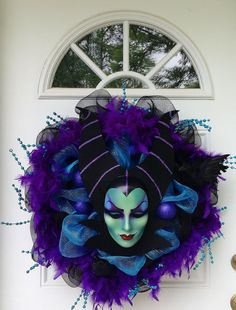 I love this. It would be perfect for a Disney themed Halloween, though it would work for Halloween without the theme. Maleficent Disney Halloween Wreath by SparkleForYourCastle on Etsy