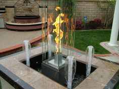 Vortex fire with water fountain. Get fire pit components from these folks