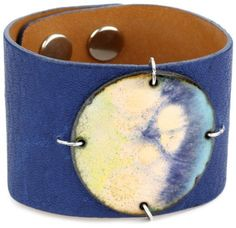 "Leighelena ""Enamel"" Leather Royal Matte and Blue Copper Adjustable Narrow Cuff Bracelet Leighelena. $82.00. Leighelena enamel and leather narrow cuff royal matte and blue copper adjustable; Enamel is glass enamel on copper, strap is Italian leather and lined with a natural cowhide.  Handcrafted in Austin, TX; Made in United States"