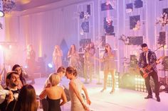 real wedding photo white silver greenery decorations at the breakers palm beach posh parties live band pink lighting fun wedding reception Breakers Palm Beach, The Breakers, Wedding Reception, Our Wedding, Tall Glass Vases, Palm Beach Florida, Lace Ball Gowns, Posh Party, Live Band
