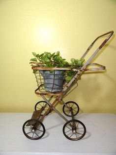 Vintage Garden Plant Stand Metal Wire  Basket on Wheels. $76.00, via Etsy.