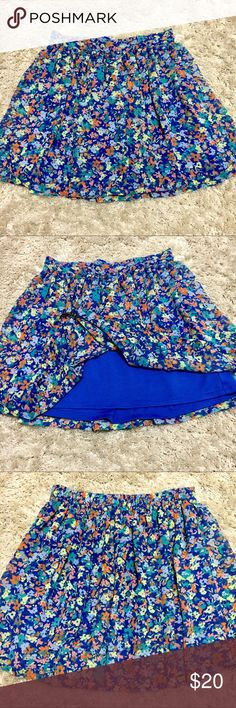 Floral skater skirt Blue floral skater skirt. So cute for the springtime! Double lined. Elastic waist in back. Size XS Arizona Jean Company Skirts