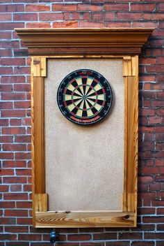 Make this dart board with doors to close and paint inside of doors with blackboard paint to keep score