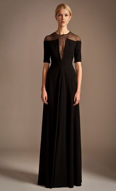 Simply exquisite, the Temperley London Long Crystal Stud Dress has a classically feminine silhouette with a fitted waist, gently flowing skirt and slim cropped sleeves. The focal point is an embellished tulle panel running from the deep v neck line and over the shoulder to the back where it fastens with a small keyhole detail. Covered in mounted, glittering crystals that run in lines to meet at the neck, it is an eye catching and beautiful gown.  Fabric Composition: 61% acetate 39% viscose…