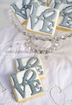 Silver and White Love Cookies~ omg would completely have this at my wedding!!! @Shona