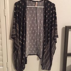 Multi-Print Kimono Bought from another posher because I thought it was long sleeves, but still super cute! The material is extremely soft, light, and flowy. Can fit sizes L-XXL comfortably. I've never worn it and the previous owner wore it once  Mudd Sweaters Cardigans