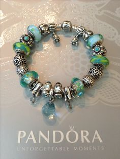 My clear teal flowers, Aqua-green swirl and polka dots teal Murano glass charms and flower Pandora bracelet  by Nicole.