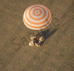 Expedition 32 Landing - The Soyuz TMA-04M spacecraft is seen as it lands with Expedition 32 Commander Gennady Padalka of Russia, NASA Flight Engineer Joe Acaba and Russian Flight Engineer Sergie Revin in a remote area near the town of Arkalyk, Kazakhstan, on Monday, September 17, 2012. Padalka, Acaba and Revin returned from five months onboard the International Space Station where they served as members of the Expedition 31 and 32 crews. Photo Credit: (NASA/Carla Cioffi)