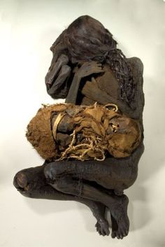 Female mummy with child, South America