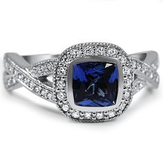Square - but rounded enough around the edges. I really like the shade of blue of this sapphire, dark. Like it very much! Bezel Halo Twist Ring from Brilliant Earth