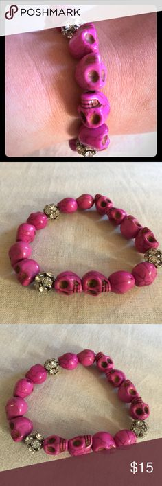 Skull Stretch Crystal Bracelet Swarovski Glam Goth Glam goth stretch bracelet in hot pink. Made of carved hot pink skull beads, with Crystal round beads mixed in. Bracelet stretches to fit any wrist. Boutique Jewelry Bracelets