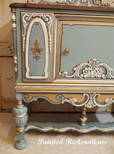 """This ornate vintage cabinet was hand-painted in General Finishes Persian Blue…"