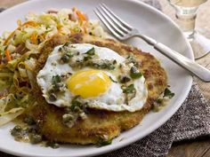 Pork Cutlets with Braised Cabbage, Fried Eggs, and a Lemon-Caper Butter Sauce