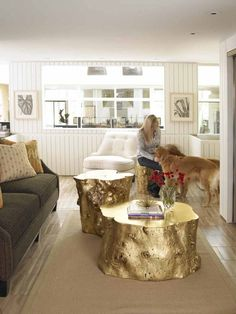 Gold tree stump coffee tables. That's about the most rustic I would ever do and its even gold!!